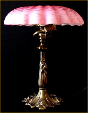 Title: Art Nouveau French Lamp - Description: Early 1900s French Art Nouveau boudouir lamp, cast floral base and ruffled centre mounted pink glass shade.