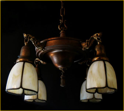 Title: Arts & Crafts Light Fixture  - Description: Circa 1900 brass pan style Arts and Crafts ceiling fixture with hand made curved four panel caramel and cream slag glass shades.