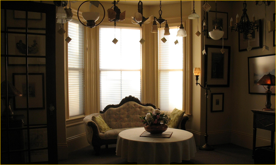 Title: Antiques Annapolis Royal Past Favourites - Description: Interior of Harris House Antique Lighting showing an assortment of antique light fixtures and lamps now sold.